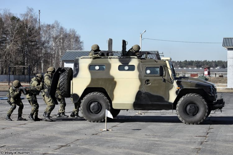 Russian police troops special forces Demonstration of close combat fighting and tactical shooting of 33rd OSN Peresvet operators under cover of GAZ-233036 SPM-2 armored vehicle and armored shields wallpaper