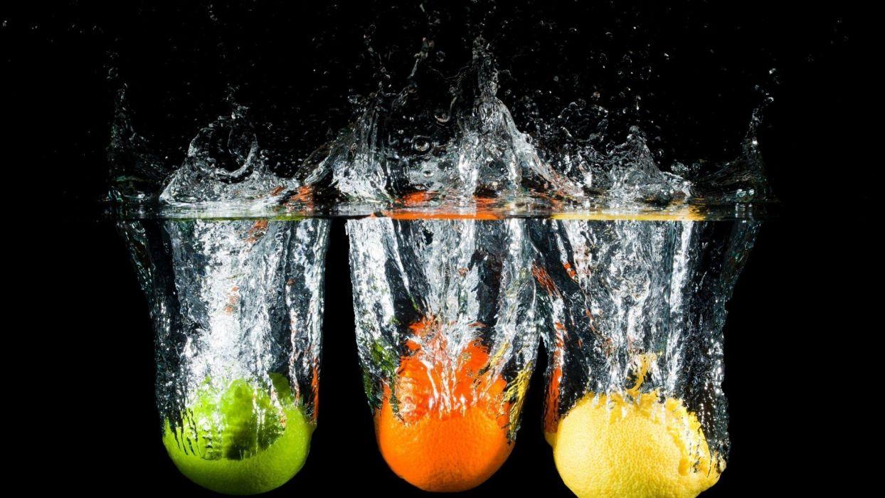 water food oranges lemons black background splashes wallpaper