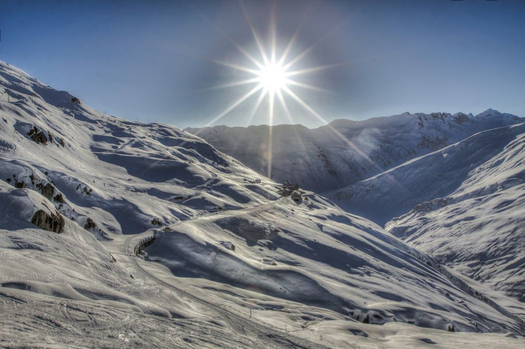 mountains sun rays light snow house   e wallpaper