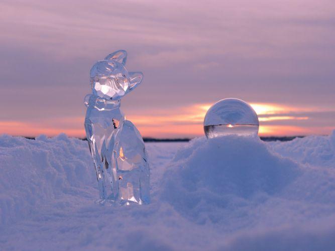 winter snow sunset sculpture cat ball bokeh wallpaper