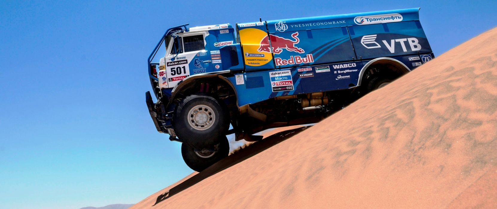 Nemesis Red-Bull KAMAZ-4911 Dakar rally sand desert Hero race truck racing 4000x1686 wallpaper