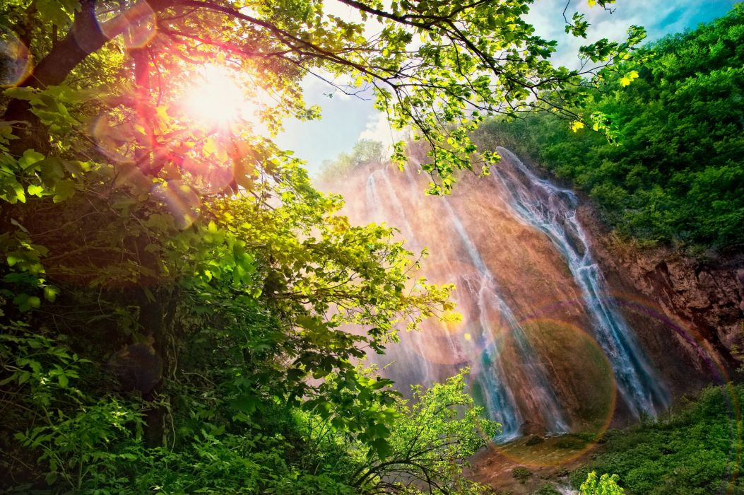 Waterfalls Rays of light Branches Nature wallpaper