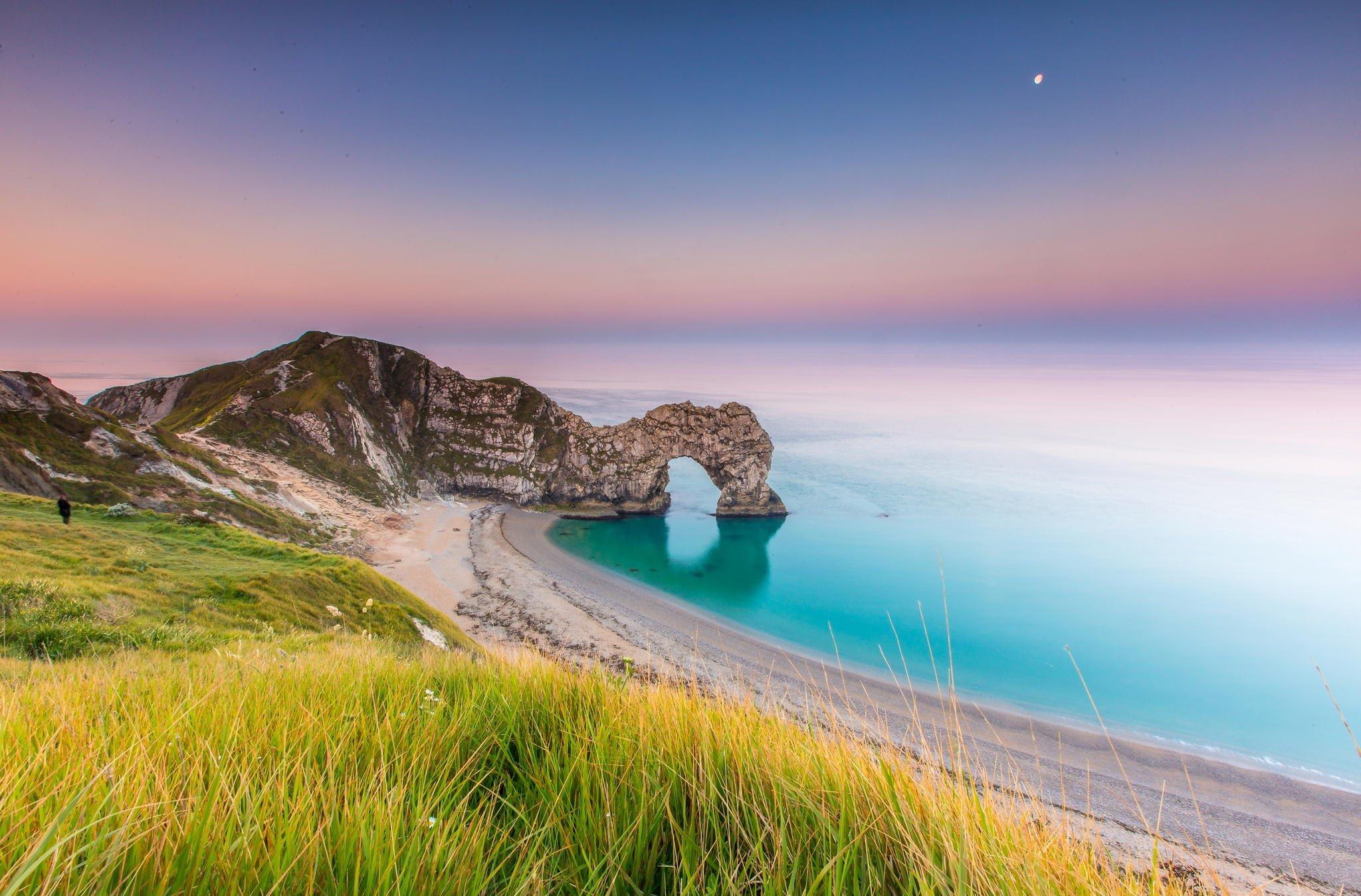 landscape nature sea sunrise coast rock arch grass england