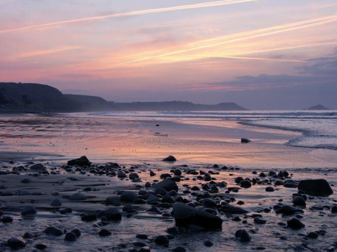 sunset rocks beach sea wallpaper