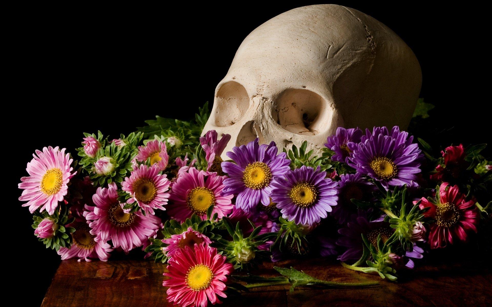 Skull flowers black background wallpaper