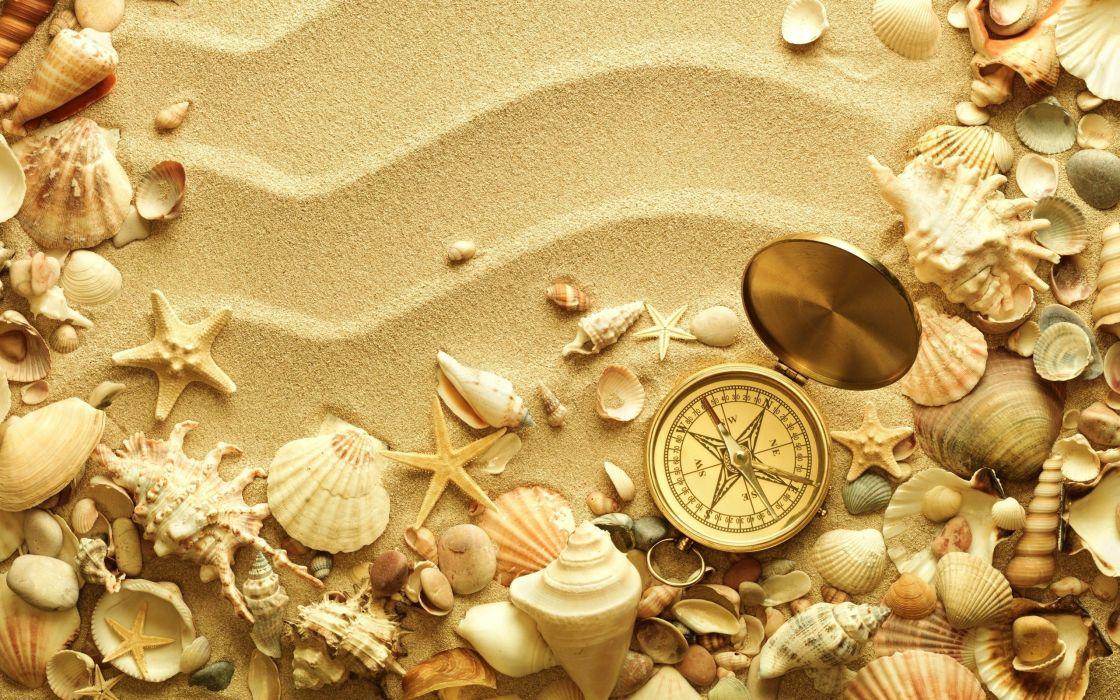 beach sand shell compass travel bokeh wallpaper