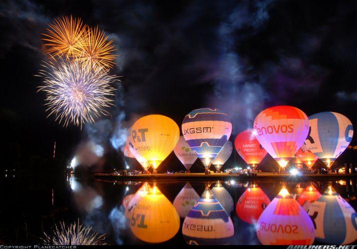 Balloons Fireworks Night Sky Lake wallpaper