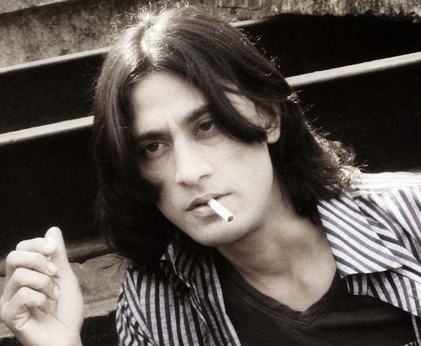 Indian Male Model Rajkumar Patra Looking sexy and disheveled that shows off his smoking style  wallpaper