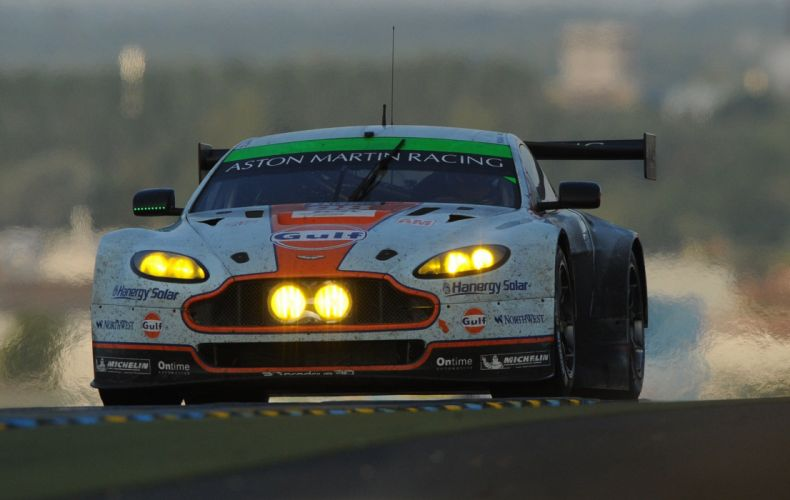 Paul Dalla Lana in his Aston Martin Vantage V 8 wallpaper