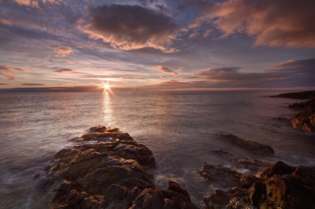 evening sun sea sunset clouds wallpaper