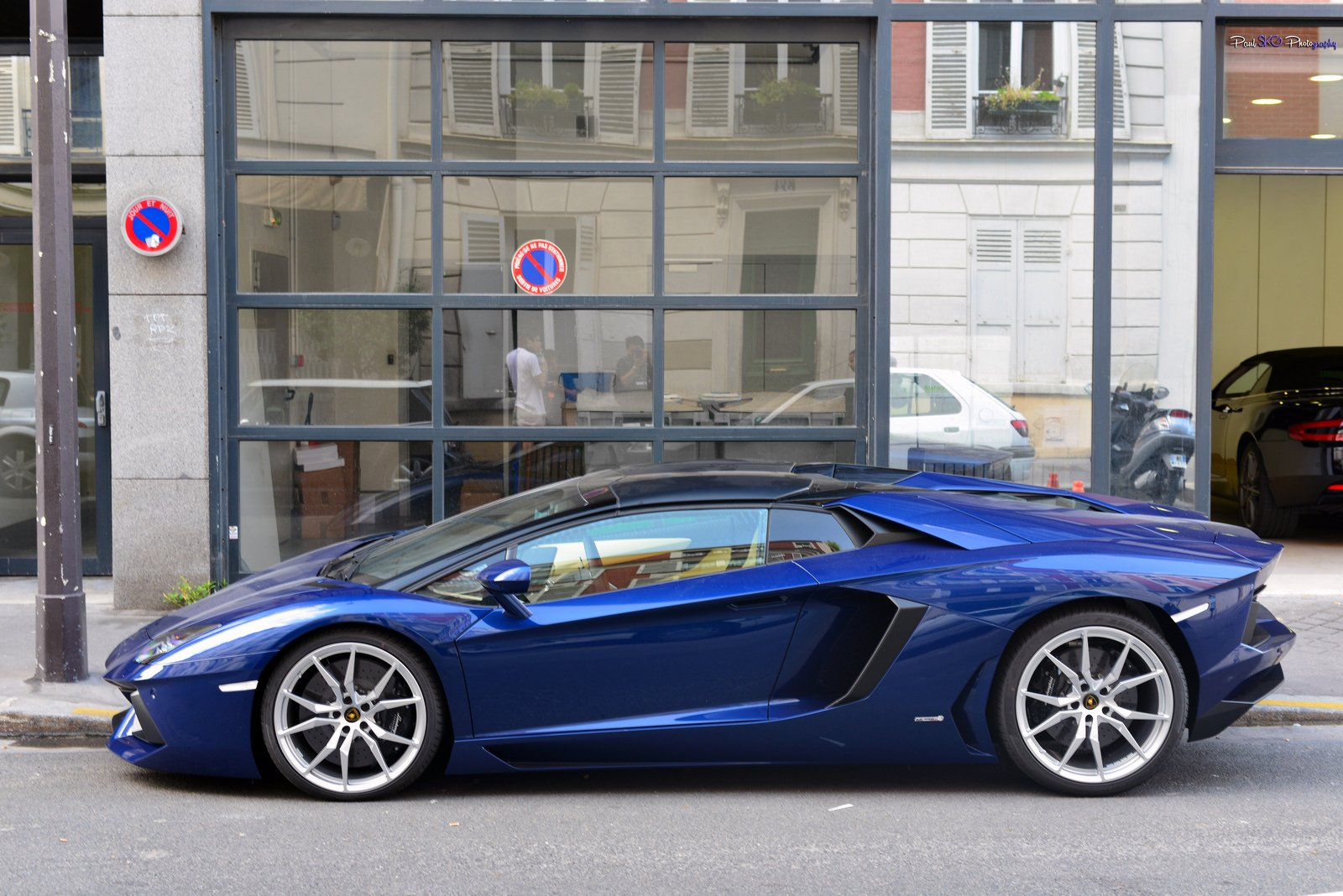 A Beautiful Dark Blue Lamborghini Aventador Roadster With A Bright