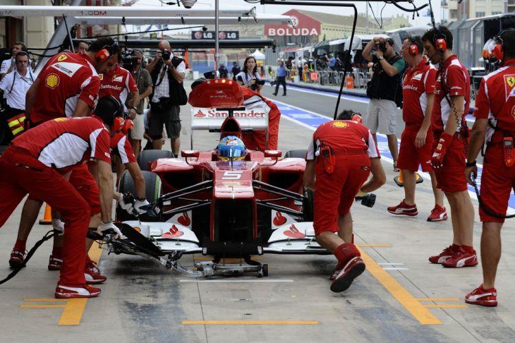 alonso massa 2012 cars f2012 Ferrari Formula one race stands pit-lane stands paddocks wallpaper