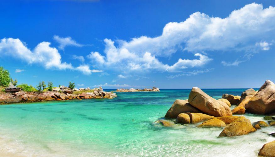 Scenery Tropics Sea Stones Clouds Nature wallpaper