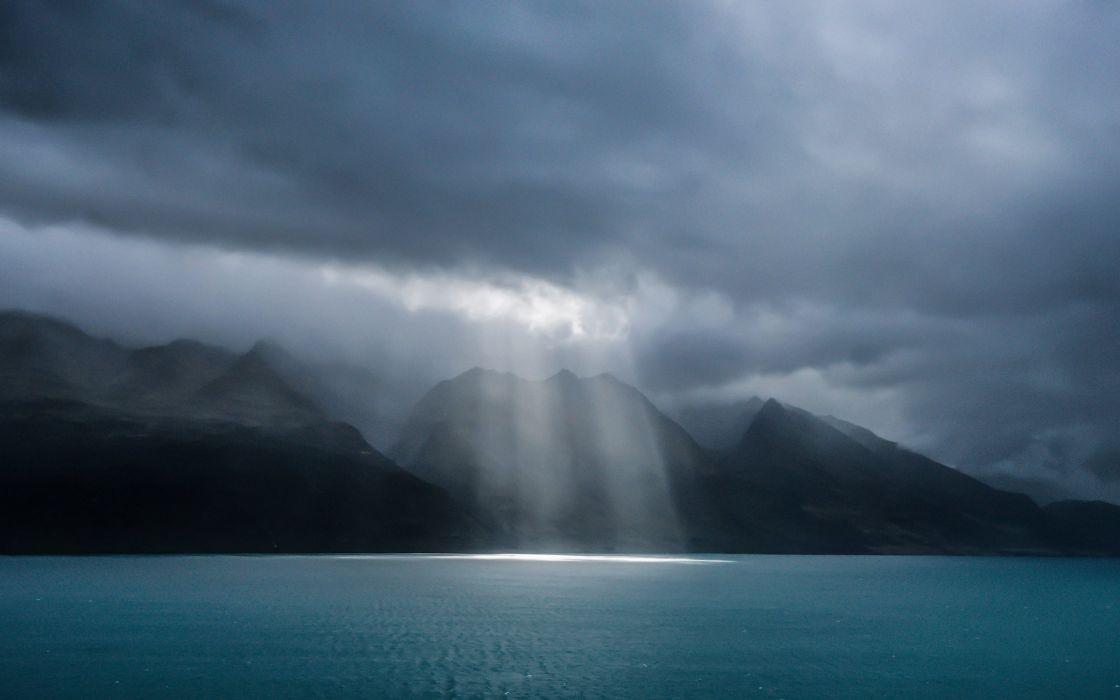spotlight new zealand lake wakatipu queenstown storm clouds wallpaper