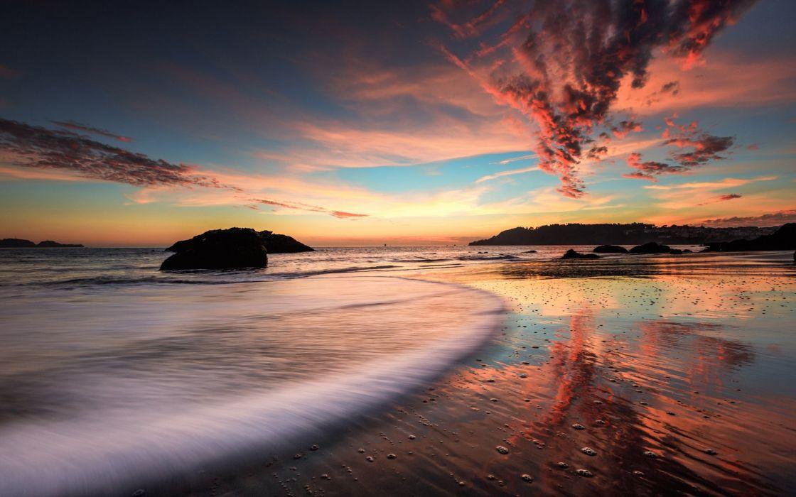 sea beach rocks evening sunset wallpaper