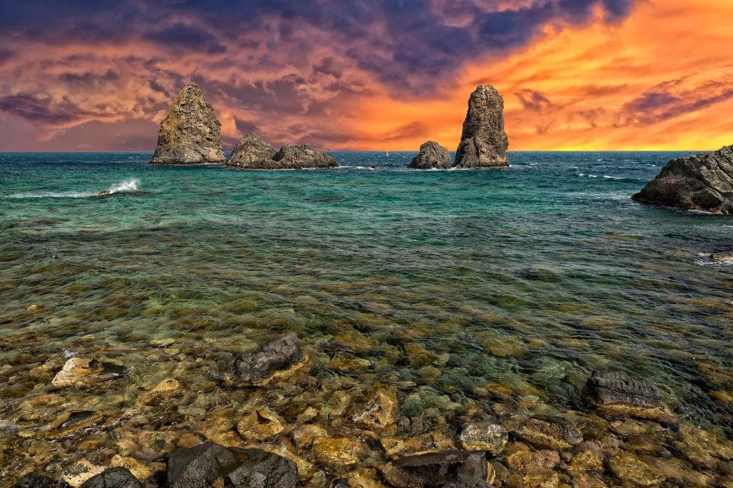 sea rocks stones sky wallpaper