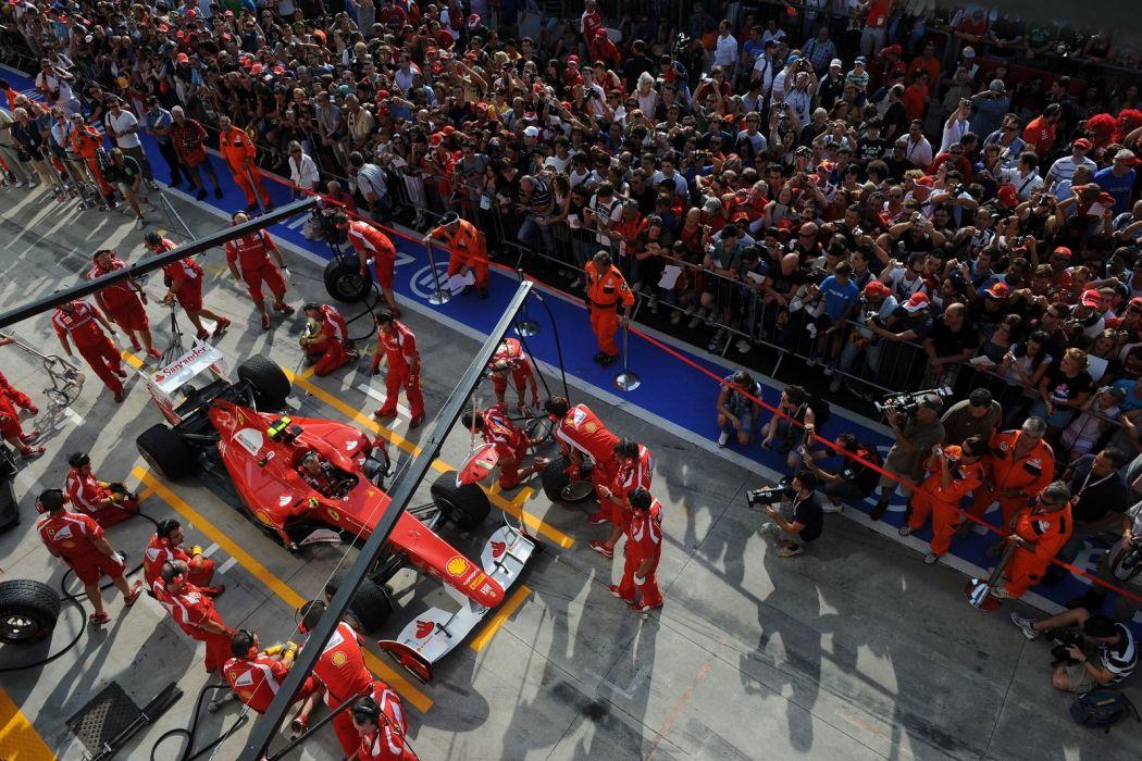 150 2011 alonso Ferrari Formula one Italia massa Race scuderia tyre change wallpaper