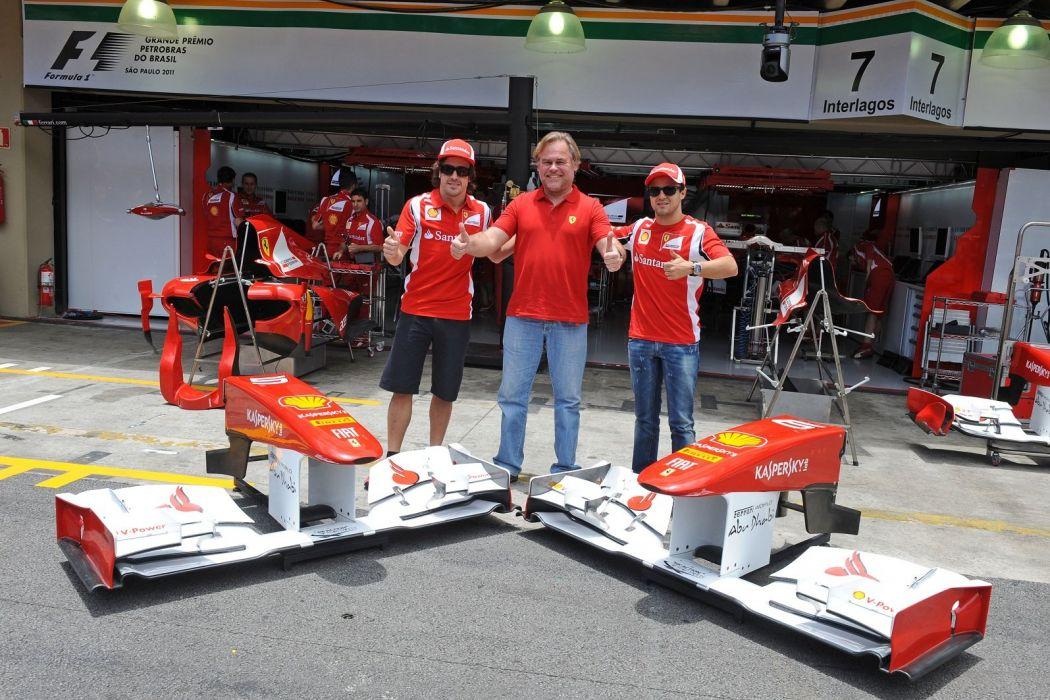 150 2011 alonso Ferrari Formula one Italia massa pitlane scuderia wallpaper