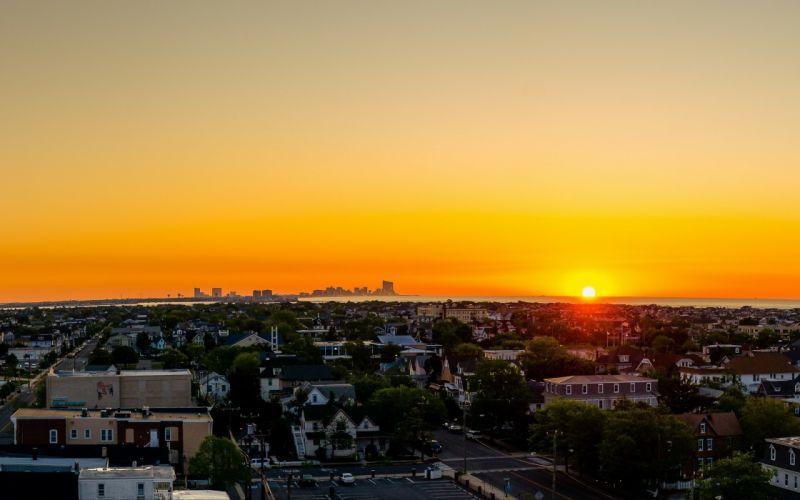 sunset evening sky city clouds wallpaper