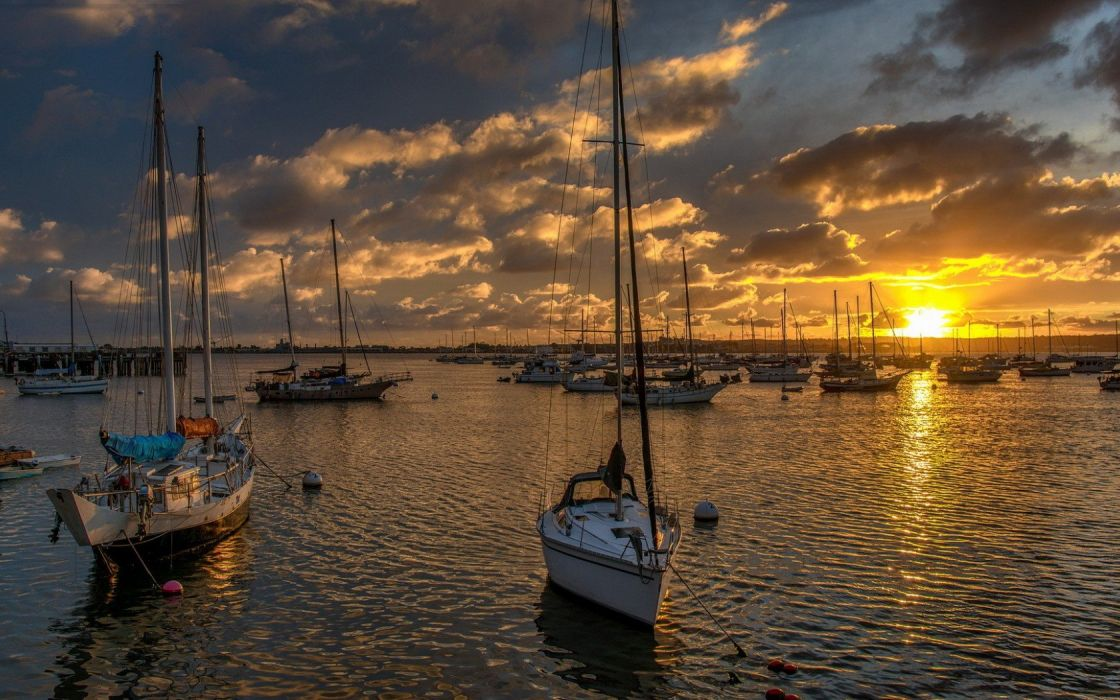 boats sea sunset clouds sky wallpaper