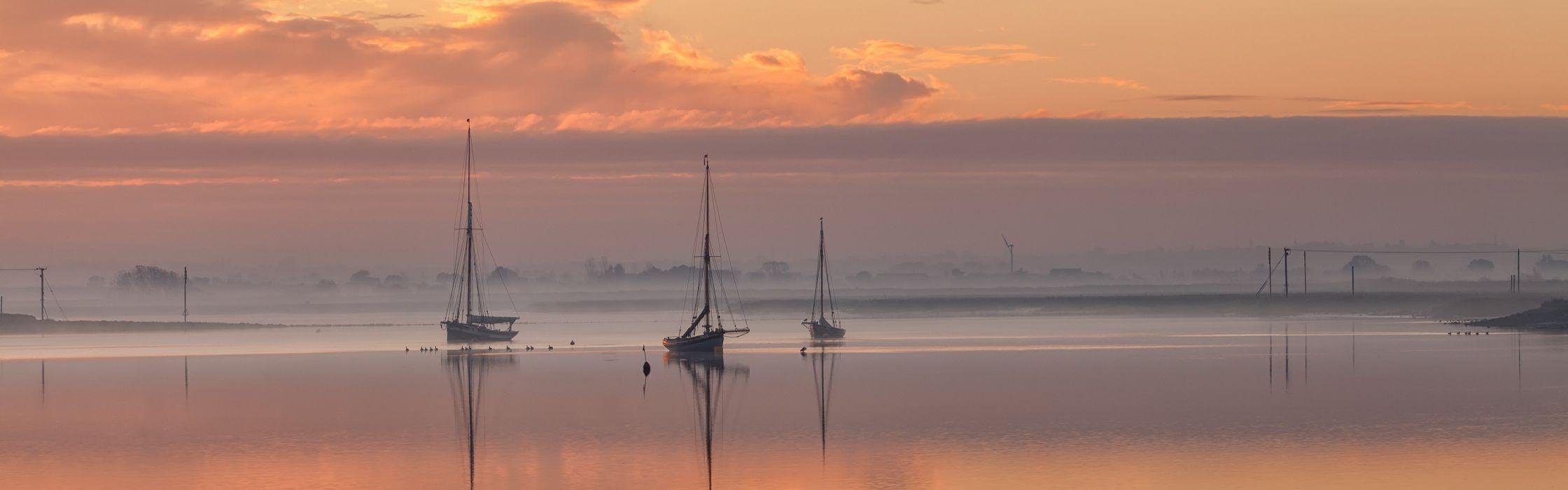 sky sea sunset night clouds boats reflection fog mist wallpaper
