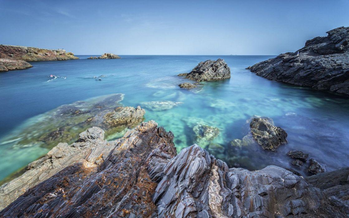 sea blue beach rocks wallpaper