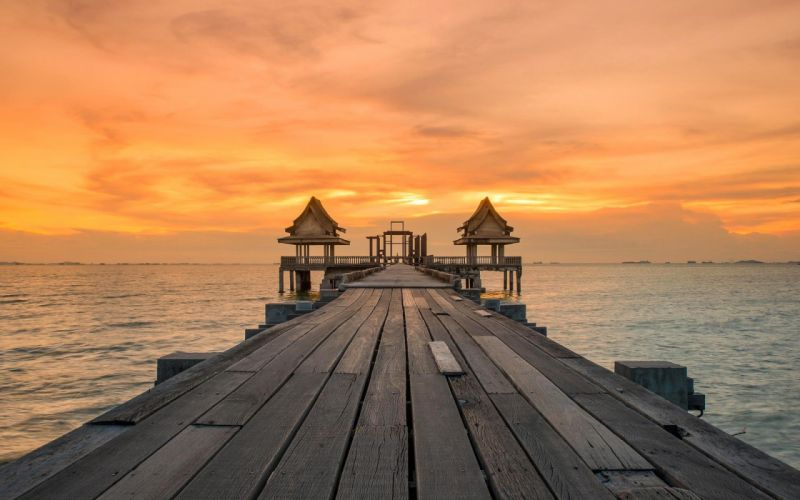 pier sunset sea clouds wallpaper