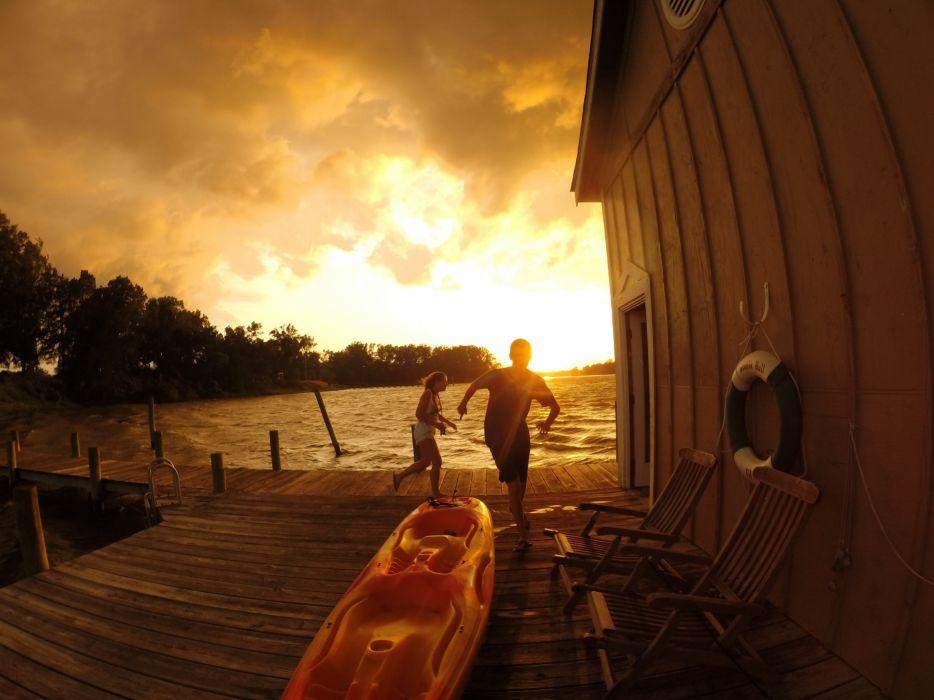 running on lake dock during sunset wallpaper