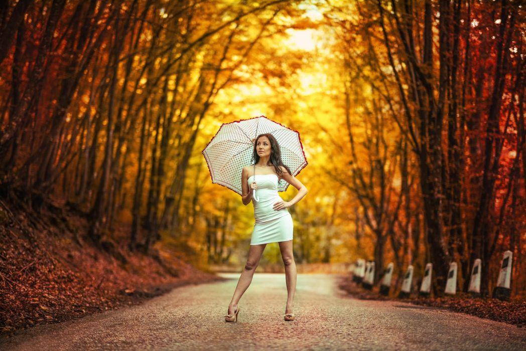 Road in autumn girl dress umbrella bokeh wallpaper