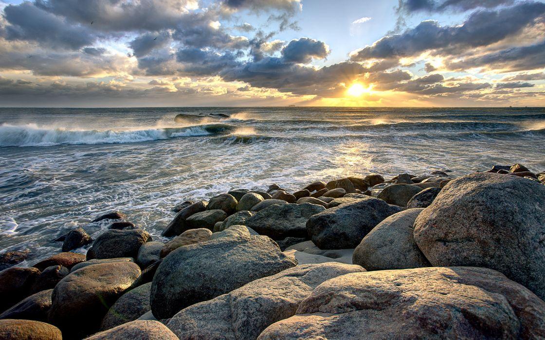sunset sea rocks nature waves wallpaper