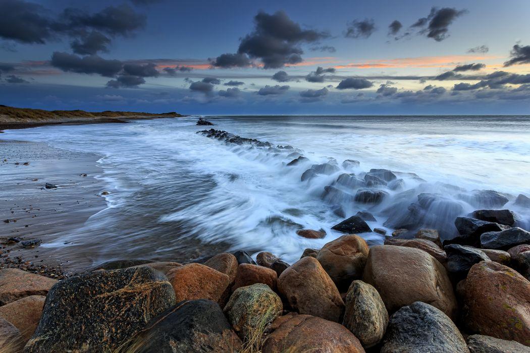sunset sea beach rocks waves Denmark landscape wallpaper