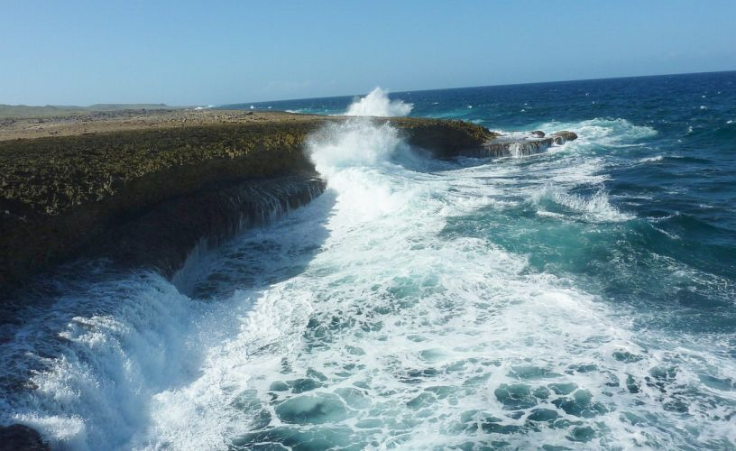 Curacao ocean waves spray rocks wallpaper