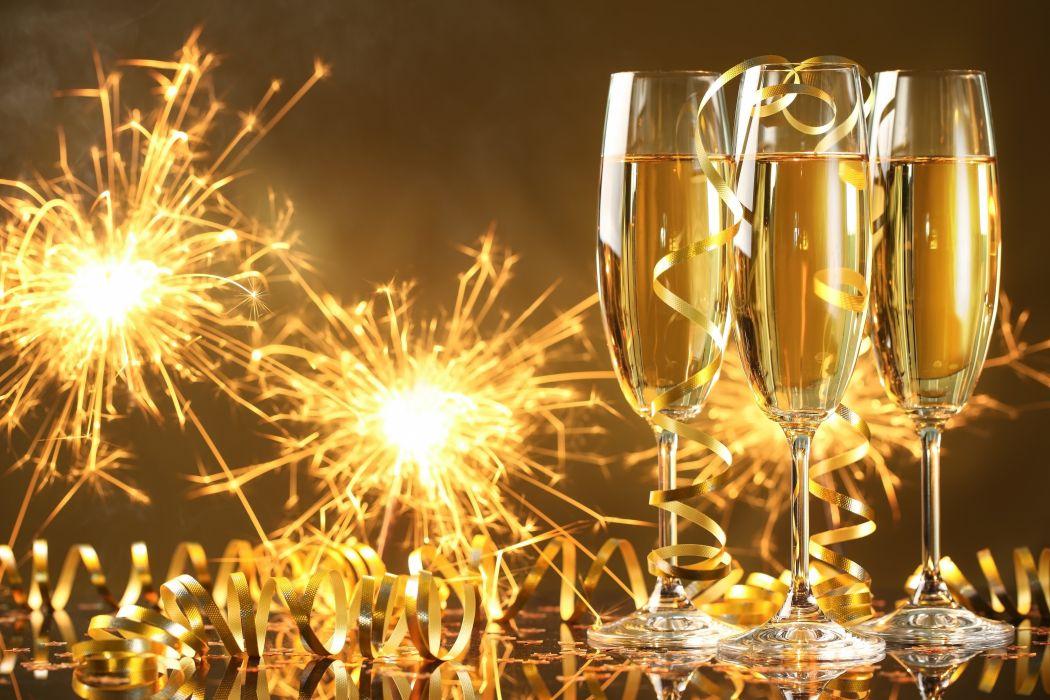 Happy New Year champagne golden celebration holiday New Year champagne glasses streamers sparklers wallpaper