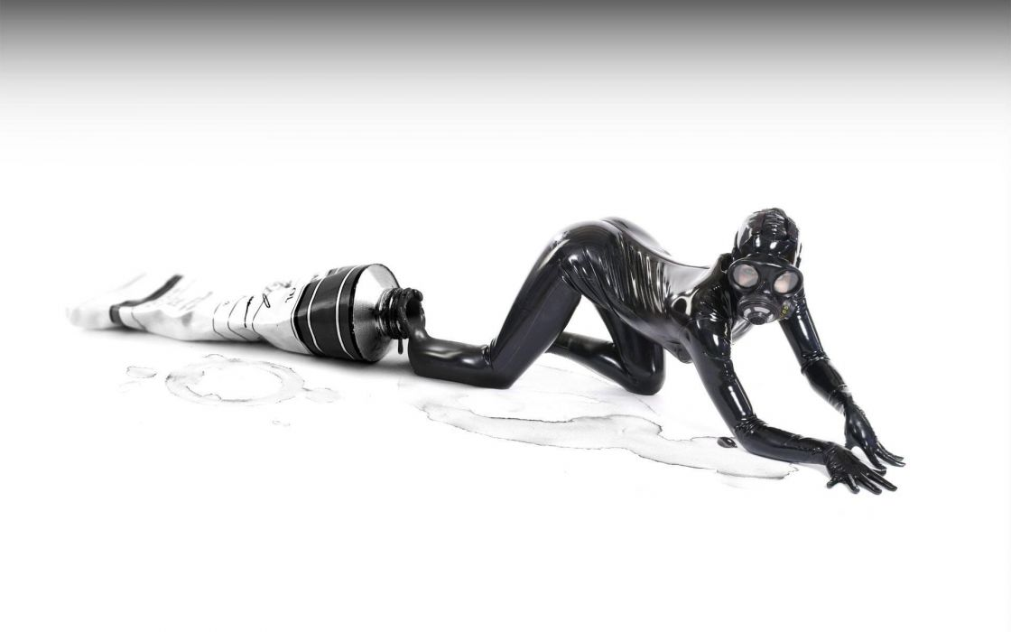 EXITING THE TUBE - girl latex mask wallpaper