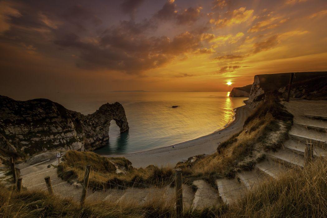 Dorset England sunset rock arch sea landscape wallpaper