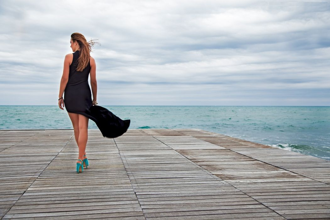 woman back hair black dress shoes heels wind sea wallpaper