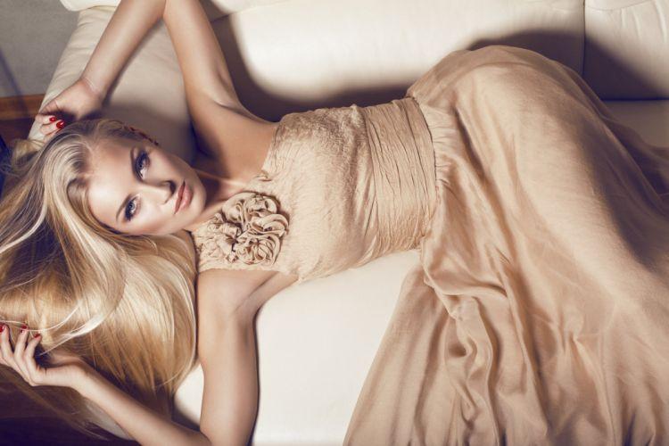 girl lies dress flower sofa hands manicure look blond wallpaper