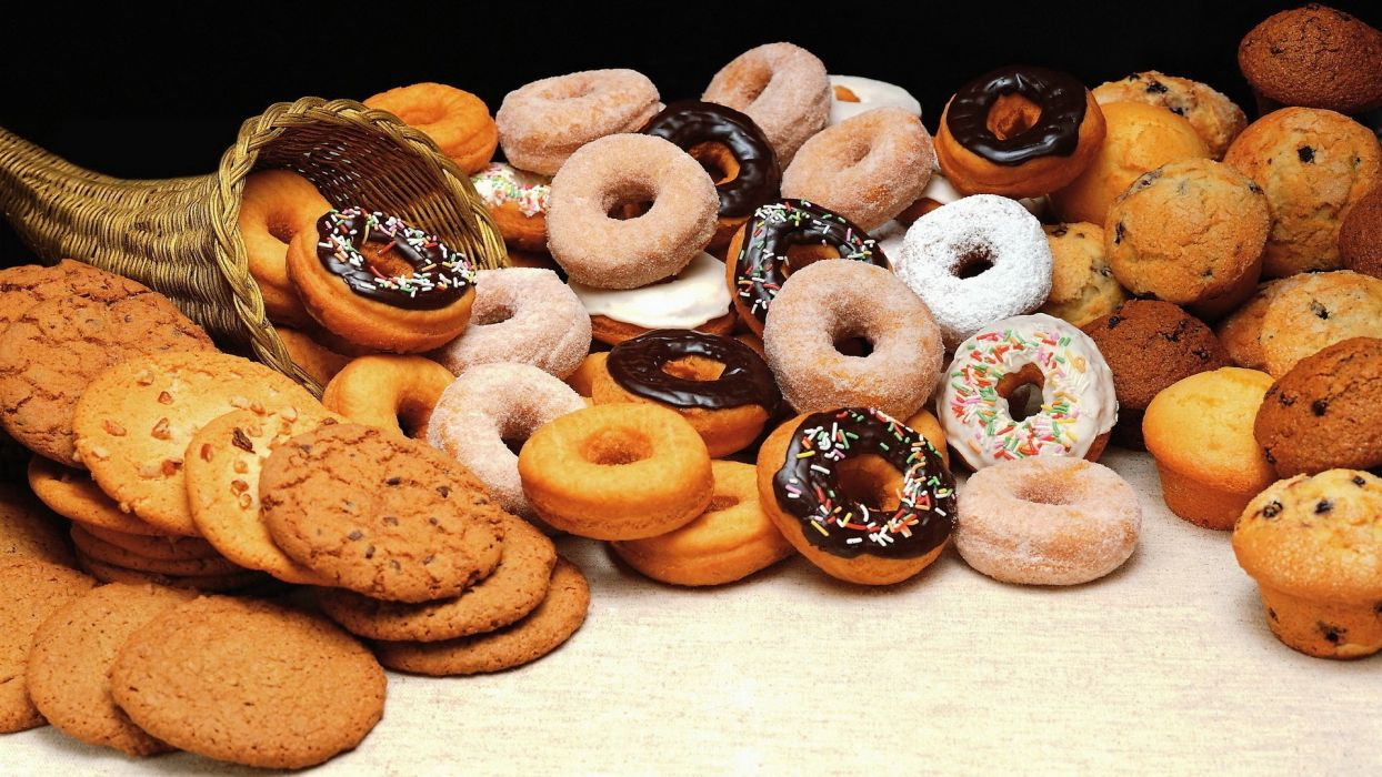 donuts goodies basket mnogoo cookies Chocolate Cupcakes with raisins with cream empty-handed with sugar powder wallpaper