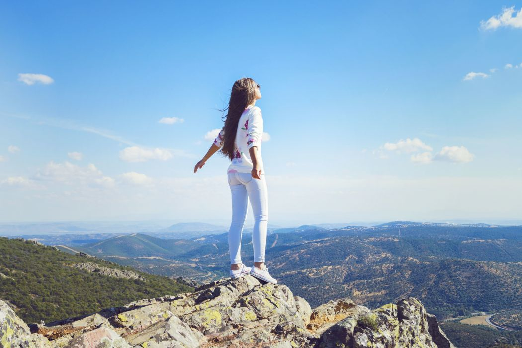 girl mountain jeans wind hair pose standing wallpaper