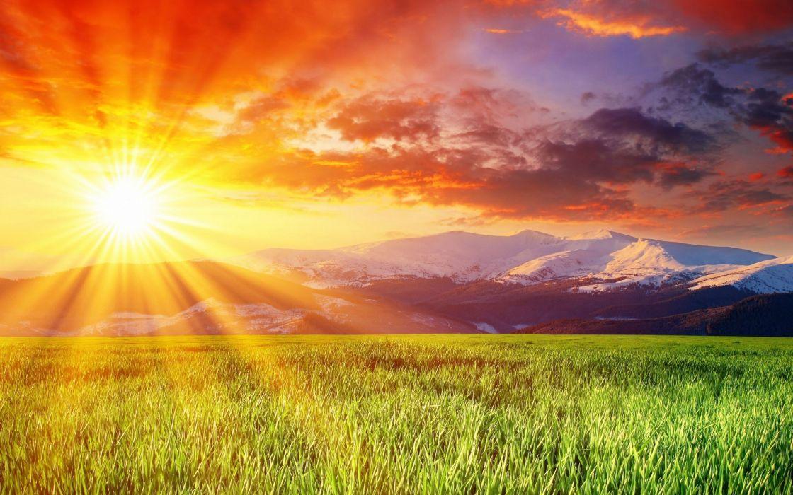 field sunlight mountains grass sky wallpaper