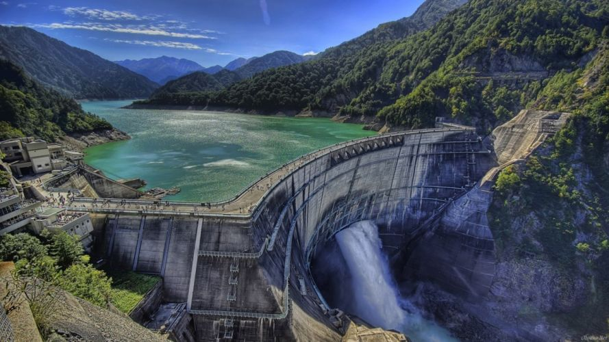 dam holds river in mountains wallpaper