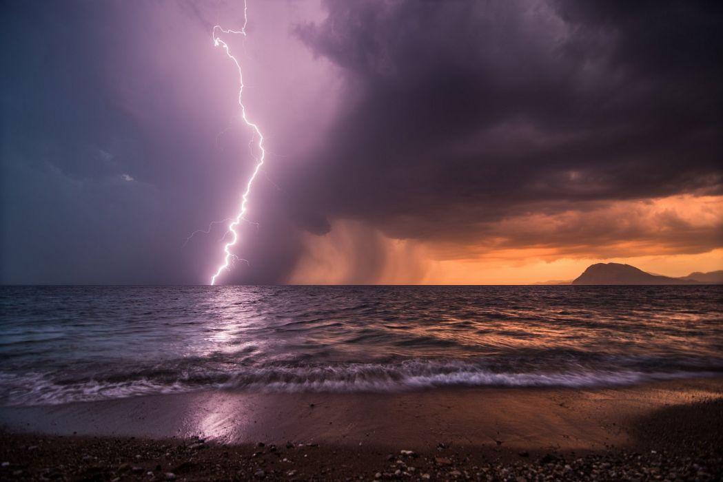 Storm lightning beach sea night ocean rain wallpaper