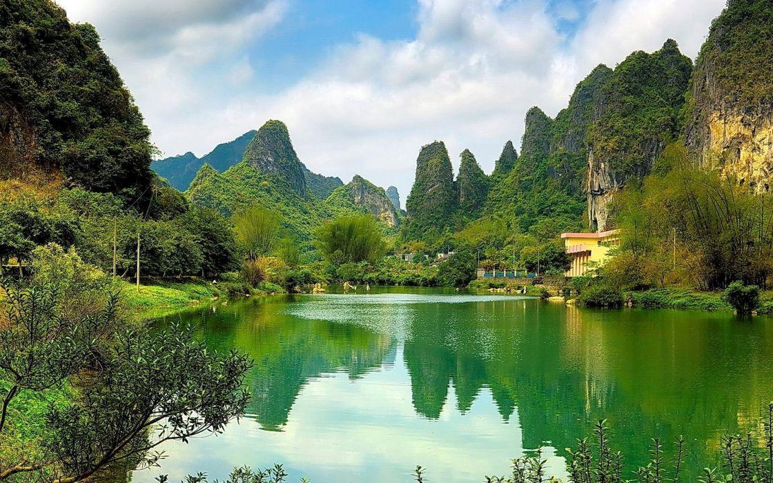 Lake Between Green Mountains wallpaper