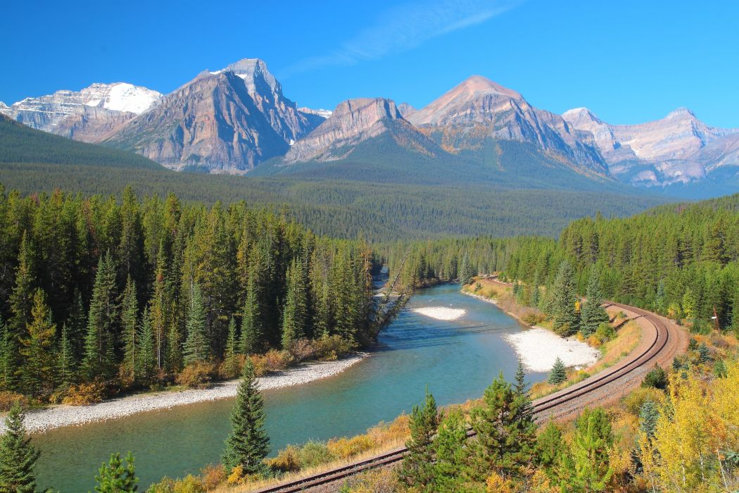 Bow River mountains train tracks railroad Banff Na wallpaper
