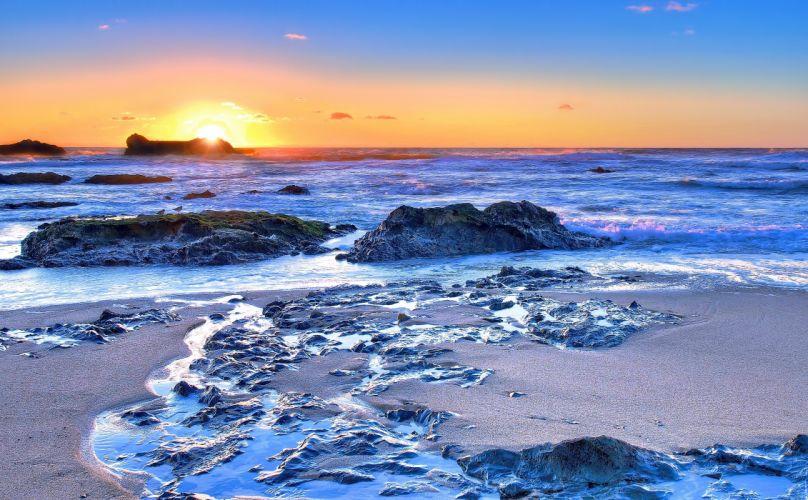 sunset sea beach rocks landscape wallpaper