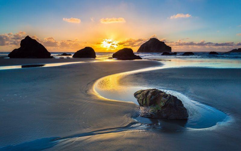 sunrise beach rocks ocean wallpaper