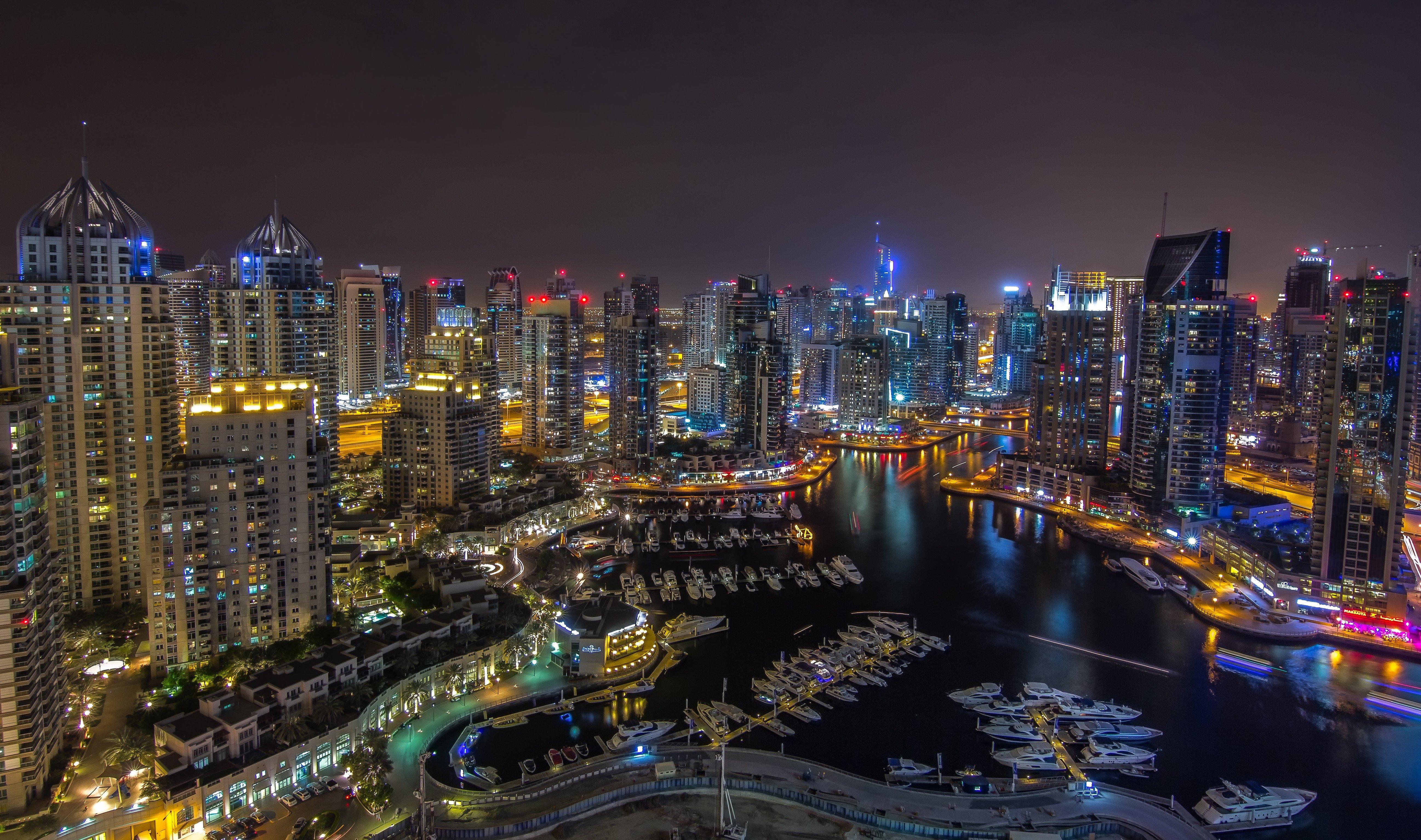 dubai uae night city panorama roads buildings skyscraper marina