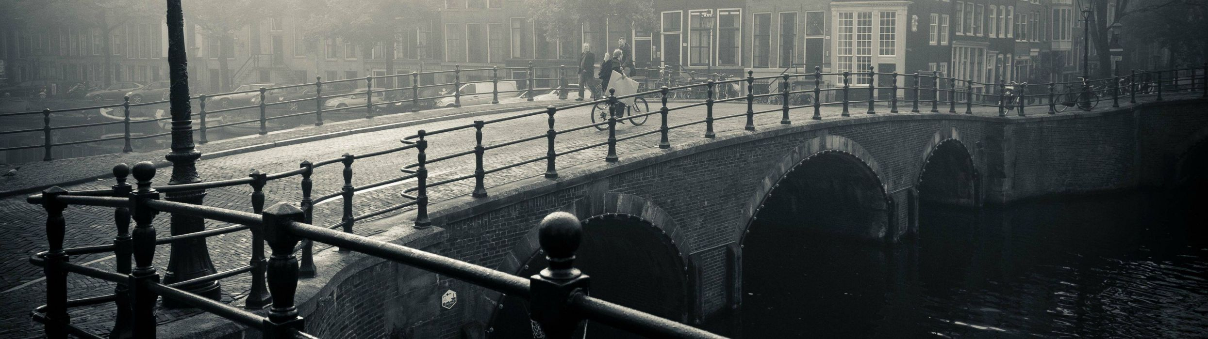 city river bridge cyclist walking downtown black and white people situation bike man mood wallpaper