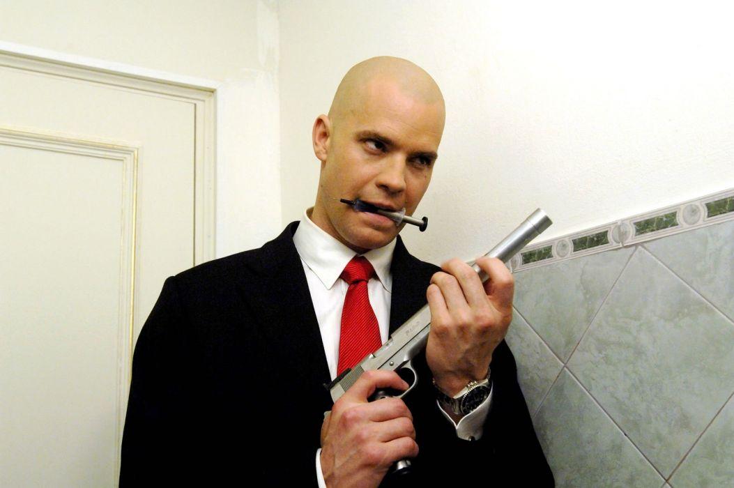 HITMAN thriller action assassin crime drama spy stealth assassins weapon gun pistol needle wallpaper