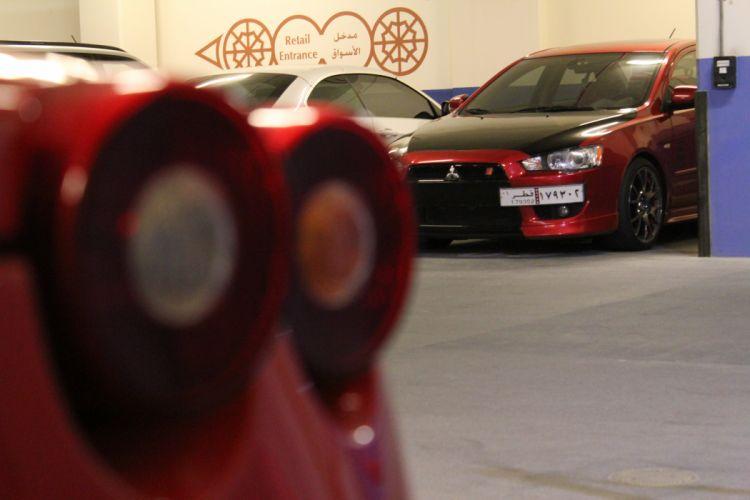 Ferrari F430 and Mitsubishi Evo X wallpaper